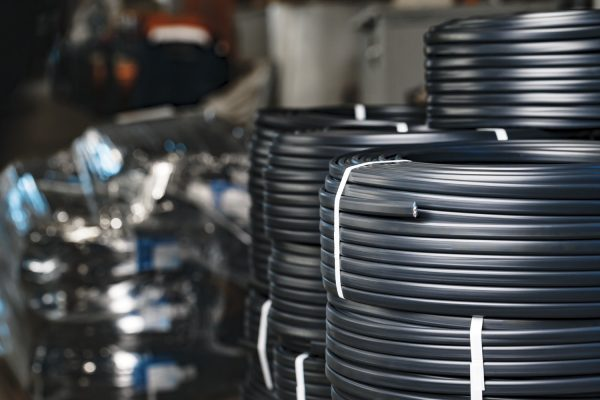 Set of black electric cable reels close up